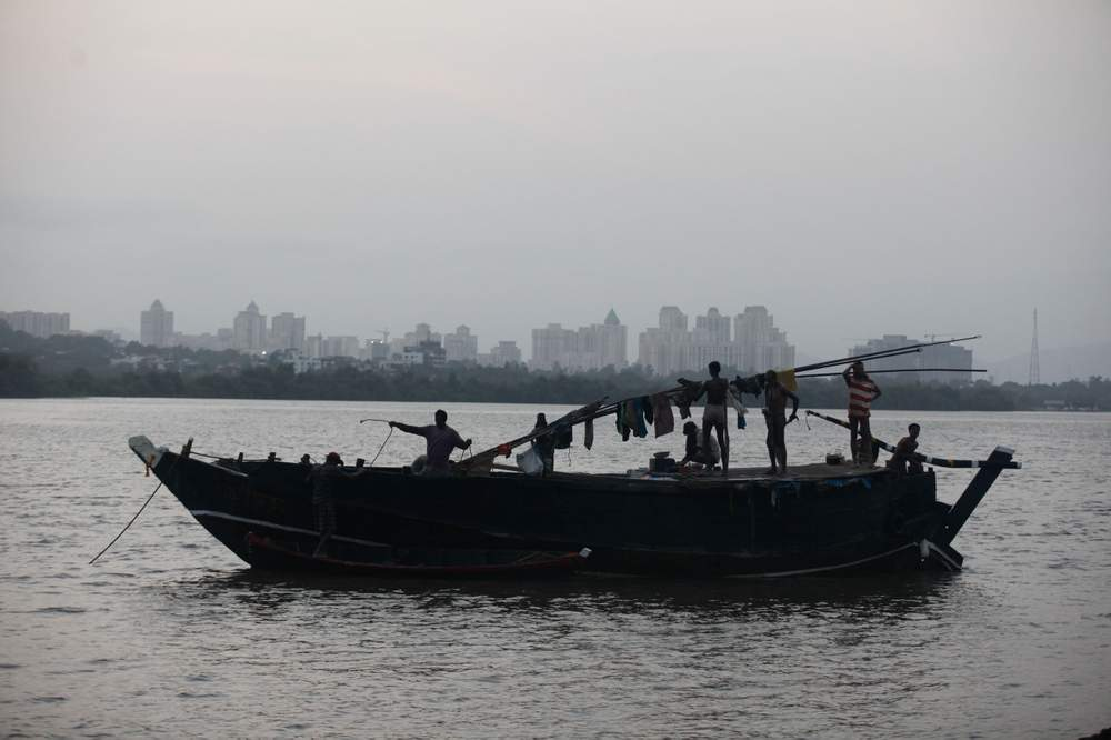 A sand mining boat on the Vasai Creek.