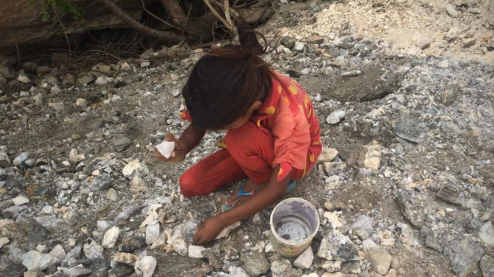 Pooja, 9, sorting mica outside a mine in Bhilwara.