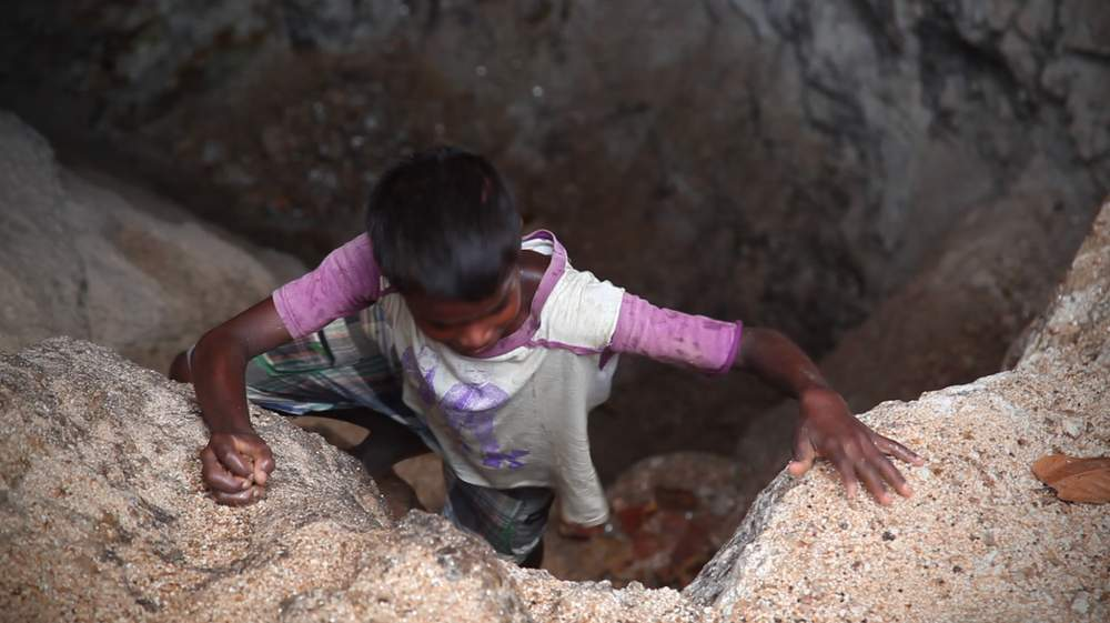 Sandeep, 10, climbs out of a Mica mine in Jharkhand.
