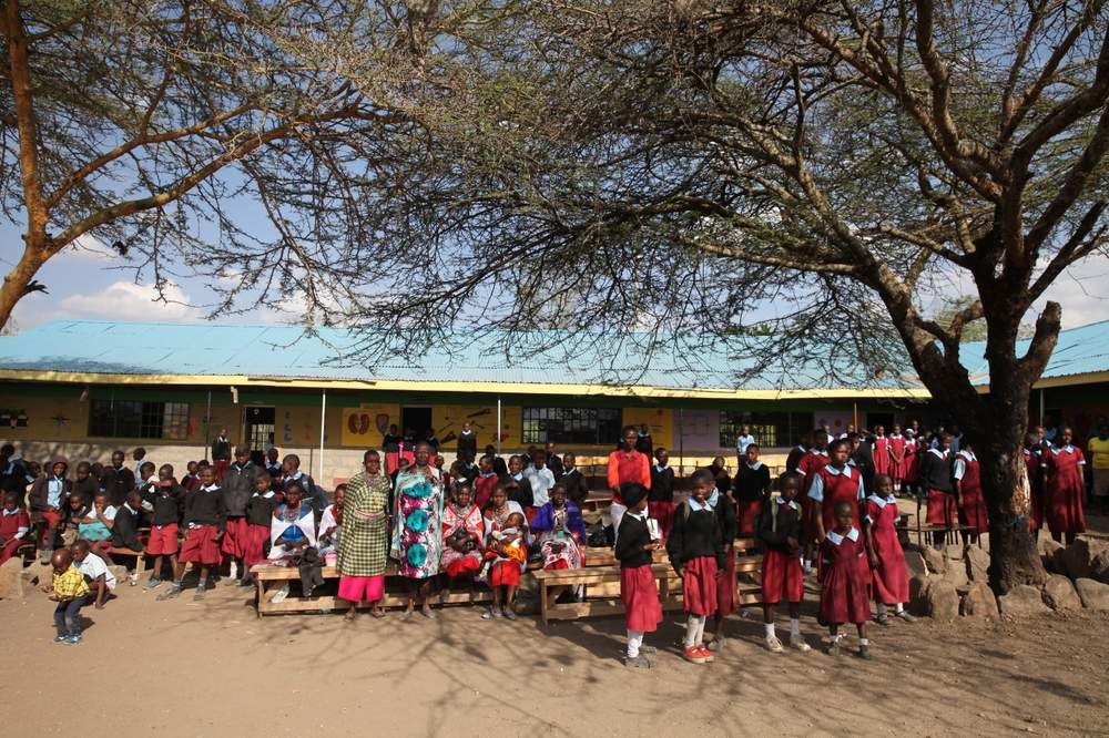 Students and parents standing outside a school in Kajiado, Kenya.