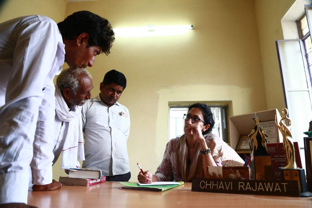 Chhavi Rajawat [seated] in her office in Soda village, Rajasthan, India.Rajawat made history as India's youngest elected village leader in 2010.