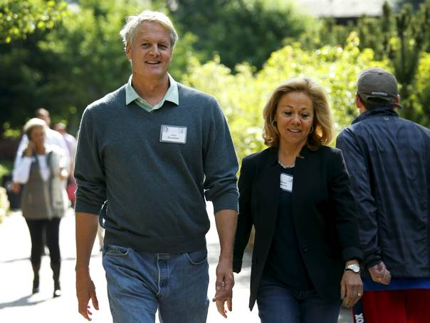 John Donahoe , President and CEO of eBay Inc, walks with his wife