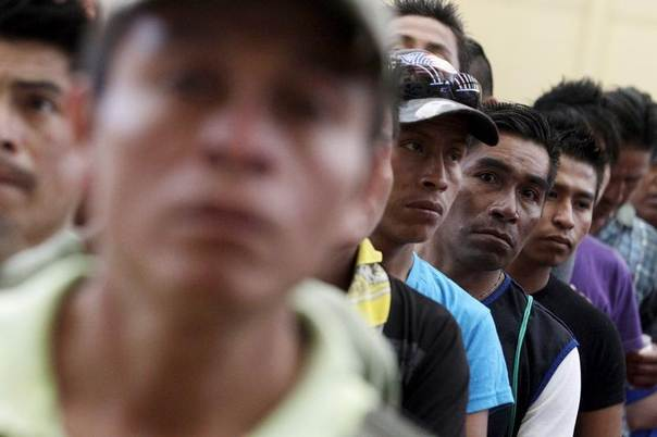 Field labourers stand in line at a gym turned shelter in Saltillo, Mexico, August 21, 2015. Some 200 people stayed at the gym after they were rescued, along with 63 minors, in an operation headed by the state attorney, from the farms of a livestock company where they were working under conditions of semi-slavery, according to local media. REUTERS/Daniel Becerril