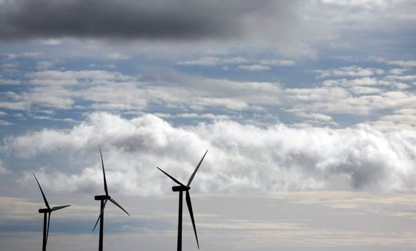 Iberdrola's power generating wind turbines are seen against cloudy sky at Moranchon wind farm in central Spain on December 17, 2012. REUTERS/Sergio Perez