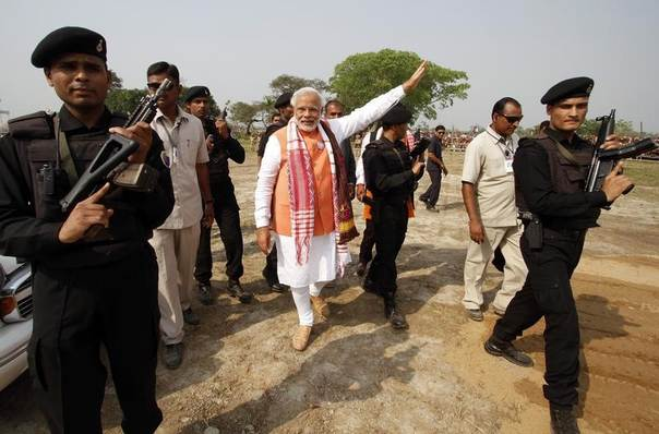 Hindu nationalist Narendra Modi (C), the prime ministerial candidate for India's main opposition Bharatiya Janata Party (BJP), is surrounded by his security personnel as he leaves after addressing an election campaign rally in Nagaon in the northeastern Indian state of Assam April 19, 2014. REUTERS/Utpal Baruah
