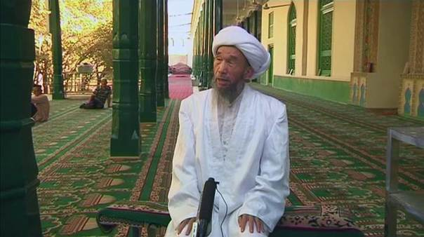 Juma Tayir speaks during an interview at Id Kah Mosque in Kashgar, China, in this still image taken from video dated August 3, 2011. REUTERS/Reuters TV