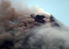 Clouds cover Mayon volcano as it spews ash during another mild eruption in Legazpi City, Philippines
