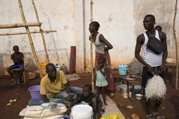 A family gathers at a camp for displaced people at M'poko International Airport in Bangui, Central African Republic, February 26, 2014. REUTERS/Camille Lepage