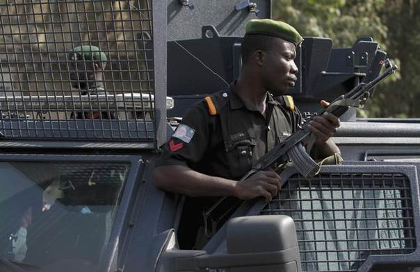 A police officer keeps watch during a protest against the elimination of a popular fuel subsidy that has doubled the price of petrol, in Nigeria's capital Abuja January 9, 2012. REUTERS/Afolabi Sotunde