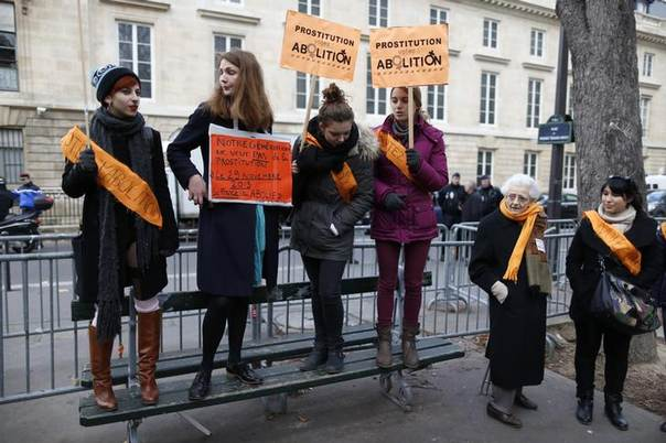 A demonstration to abolish prostitution in France at the National Assembly in Paris, where lawmakers debated a bill that would fine prostitutes' clients - a radical switch that will end France's tolerant stance and give it some of the toughest laws in Europe. Photo November 29, 2013, REUTERS/Charles Platiau