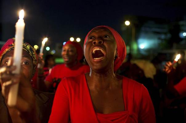 A woman shouts during a vigil in Abuja calling for the release of Nigerian schoolgirls abducted in the remote village of Chibok, May 15, 2014. REUTERS/Joe Penney