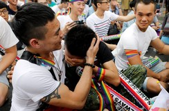 Supporters react during a rally after Taiwan legalises same-sex marriage