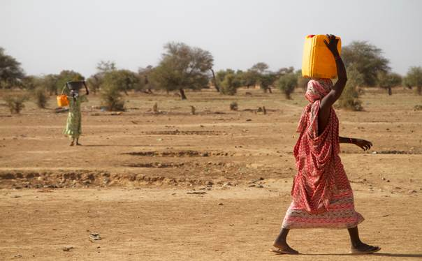 Women walk several kilometres for clean water in the Matam district of Senegal, on April 16, 2013. Thomson Reuters Foundation/Misha Hussain