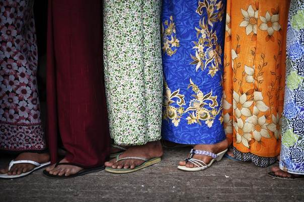 In this 2011 file photo women queue at a temple in Yangon, Myanmar. REUTERS/Damir Sagolj