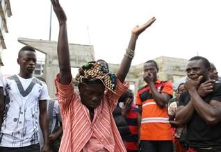 Facing risk of disease, Sierra Leone buries mudslide dead