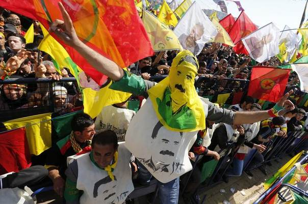 A person wearing pictures of jailed Kurdish militant leader Abdullah Ocalan of the Kurdistan Workers Party (PKK) gestures during a gathering celebrating Newroz, which marks the arrival of spring and the new year, in Diyarbakir, Turkey, March 21, 2014. REUTERS/Umit Bektas