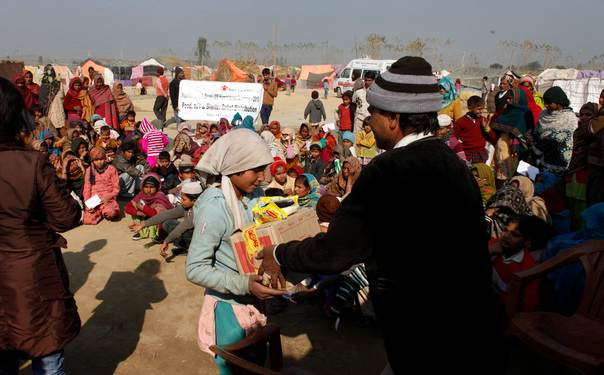 Relief distribution by Save the Children comes handy for people braving severe winter in relief camps (Photo: Save the Children)