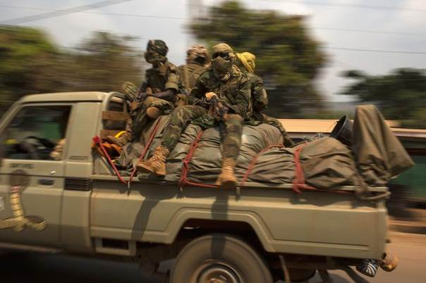 Chadian soldiers, part of the African Union (AU) peacekeeping mission in the Central African Republic, escort a convoy of trucks carrying people and their belongings during a road repatriation to Chad in the capital Bangui January 22, 2014 REUTERS/Siegfried Modola