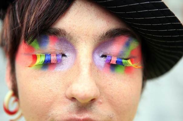 A participant in Northern Ireland's Gay Pride parade poses for photographers in Belfast August 1, 2009 REUTERS/Cathal McNaughton
