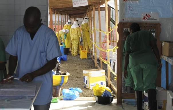 Medicins Sans Frontieres (MSF) health workers prepare at ELWA's hospital isolation camp during the visit of Senior United Nations (U.N.) System Coordinator for Ebola, David Nabarro, in Monrovia, Liberia, August 23, 2014.  REUTERS/2Tango
