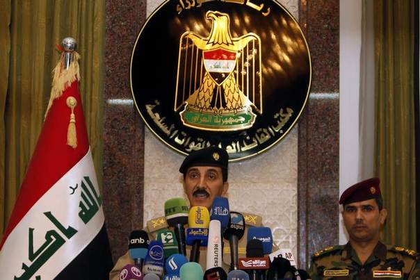 Major-General Qassim al-Moussawi, spokesman for the Iraqi military's commander-in-chief, speaks during a news conference in Baghdad June 14, 2014. REUTERS/Ahmed Saad