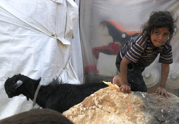 A Syrian refugee child living in a makeshift camp in North Lebanon