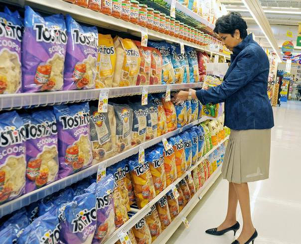PepsiCo CEO Indra Nooyi checks products at the Tops SuperMarket in Batavia, New York, June 3, 2013. REUTERS/Don Heupe