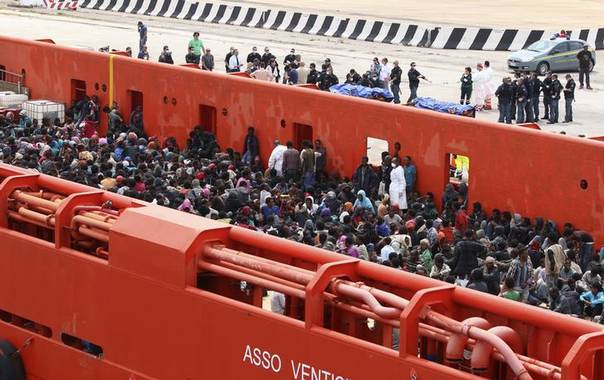 Migrants are seen aboard a navy ship before being disembarked in the Sicilian harbour of Augusta June 1, 2014 REUTERS/Antonio Parrinello
