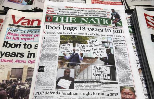 In this 2012 file photo, newspapers, with details of the sentencing of James Ibori, are seen on a a news-stand in Lagos REUTERS/Akintunde Akinleye