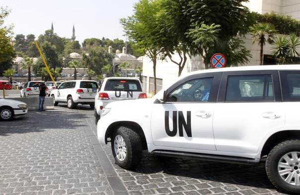 United Nations (U.N.) vehicles transport a team of U.N. chemical weapons experts to the scene of a poison gas attack outside the Syrian capital last week, in Damascus August 26, 2013 REUTERS/Khaled al-Hariri