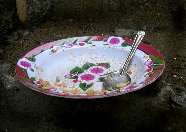 An empty plate is shown in Iwaya, one of the poorest areas of Lagos, in this undated photograph taken by a child, part of an exhibition in which hundreds of Nigerian kids from the richest and poorest homes in Lagos have documented their lives through pictures. REUTERS/Friday Zannu/Handout