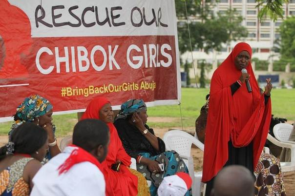 A member of the #BringBackOurGirls Abuja campaign group addresses a sit-in protest at the Unity Fountain in Abuja June 18, 2014. REUTERS/Afolabi Sotunde