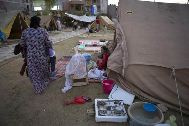 Internally displaced people from the Yazidi minority take shelter at Bahirka Camp in Arbil, August 12, 2014. REUTERS/Youssef Boudlal