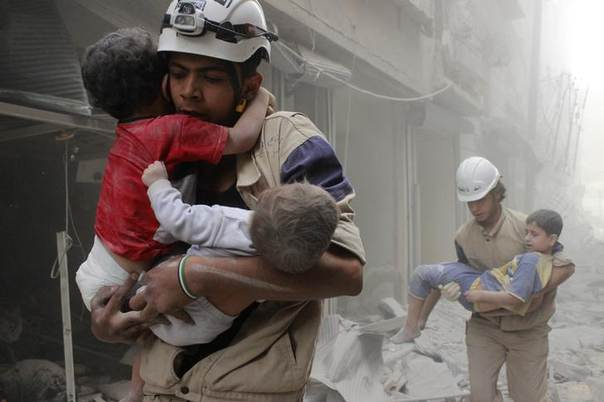 Members of the Civil Defence rescue children after what activists said was an air strike by forces loyal to Syria's President Bashar al-Assad in al-Shaar neighbourhood of Aleppo June 2, 2014. REUTERS/Sultan Kitaz
