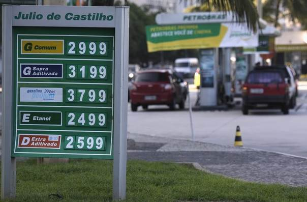 The prices of gasoline, ethanol and diesel fuel are shown at a gas station at Copacabana Beach in Rio de Janeiro, Nov. 29, 2013. REUTERS/Ricardo Moraes