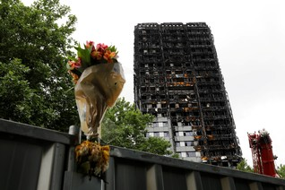 FEATURE-Survivors of Britain's Grenfell inferno homeless for Xmas