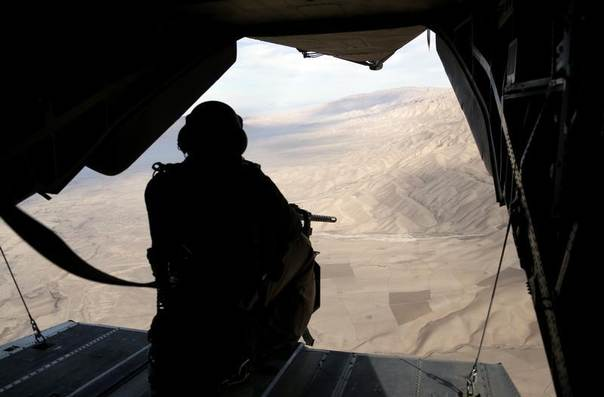 A German Bundeswehr army gunner mans his weapon on board a CH-53 helicopter during a flight from Kunduz to the German army combat outpost OP North, near Baghlan, northern Afghanistan, December 5, 2012. REUTERS/Fabrizio Bensch