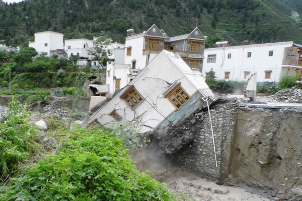 A house is seen damaged after a landslide in Aba Tibetan and Qiang Autonomous Prefecture, Sichuan Province, China, on July 11, 2013. REUTERS/Stringe