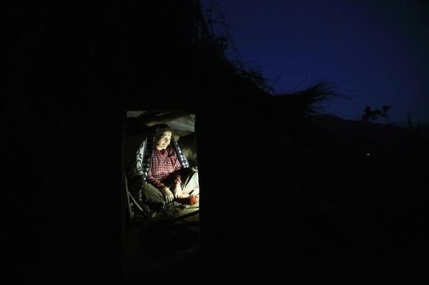Dhuna Devi Saud prepares to sleep inside a Chaupadi shed in the hills of Legudsen village in Achham District in western Nepal, February 16, 2014. REUTERS/Navesh Chitrakar