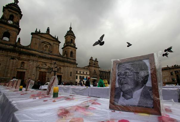 A photograph of victim missing or killed in armed conflict in Colombia is displayed during a tribute at Bolivar Square in Bogota, on Oct. 18, 2012. REUTERS/John Vizcaino