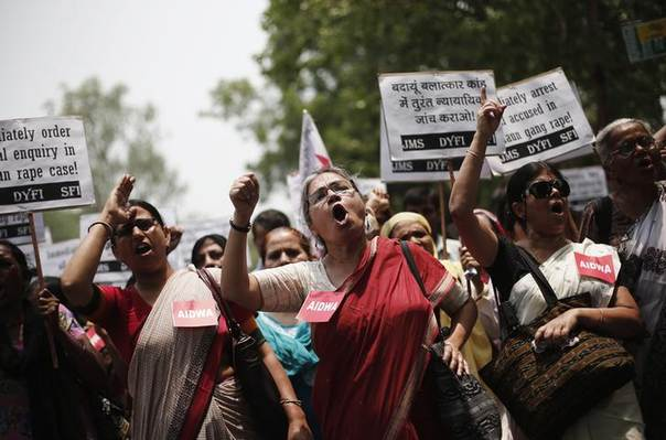 Demonstrators in New Delhi hold placards and shout slogans during a protest against the recent rape and killing of two teenage girls in Uttar Pradesh state. Picture May 31, 2014, REUTERS/Adnan Abidi
