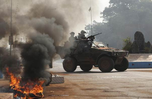 French troops secure an area along a street in Bangui, January 19, 2014. REUTERS/Emmanuel Braun