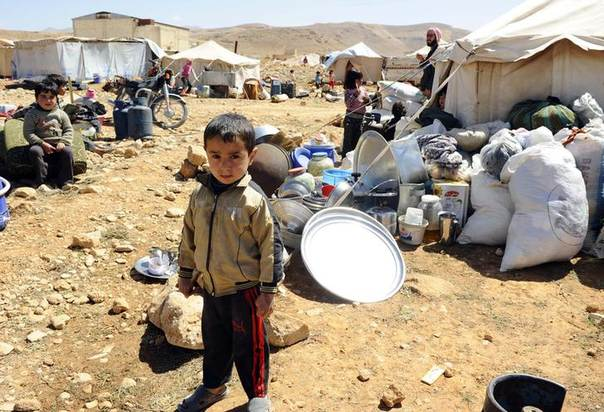 A Syrian refugee child who fled the violence from the Syrian town of Flita, near Yabroud, poses for a photograph at the border town of Arsal, in the eastern Bekaa Valley March 20, 2014.  REUTERS/Hassan Abdallah