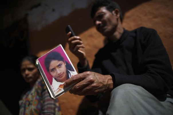 Yagraj Bhul holds a portrait of his daughter Sarmila who died a year ago while she was practicing Chaupadi in Ridikot Village in Achham District in western Nepal, February 17, 2014. REUTERS/Navesh Chitrakar