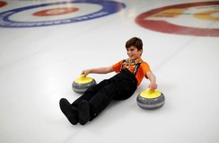 A Yazidi refugee boy from Kurdistan learns the sport of curling in Toronto