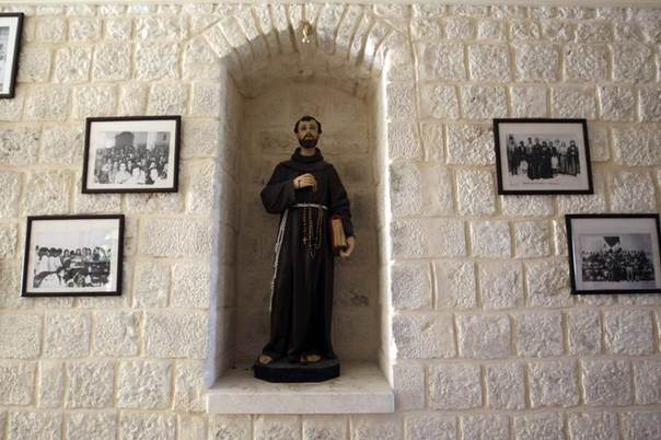 A statuette and photographs are seen at a monastery in al-Quniya village in Idlib province May 27, 2013.  REUTERS/Muzaffar Salman
