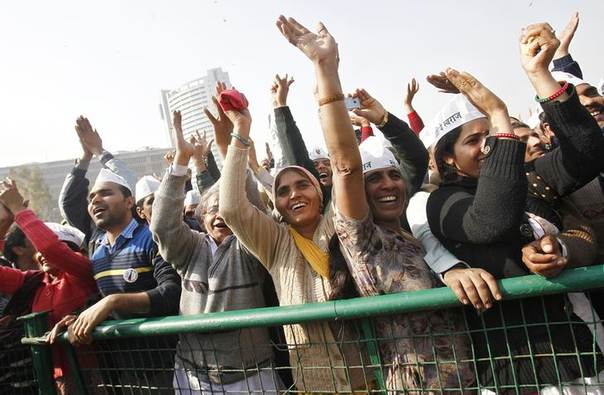 Supporters of Aam Aadmi Party (AAP) cheer after its leader Arvind Kejriwal took an oath as the new chief minister of Delhi, December 28, 2013. REUTERS/Anindito Mukherjee