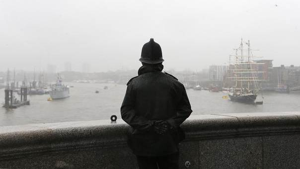 A policeman looks out over the River Thames from Tower Bridge in central London June 3, 2012.