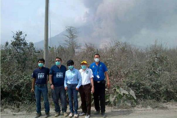 SRT volunteers Vensentius Dwijatmoko (left) and Jamie Adams (second from left) with local Rotary club contacts assessing the need at Mount Sinabung, Indonesia, February 2014.