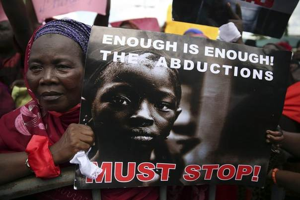 A woman holds a sign during a protest demanding the release of abducted secondary school girls from the remote village of Chibok, in Lagos May 5, 2014. REUTERS/Akintunde Akinleye